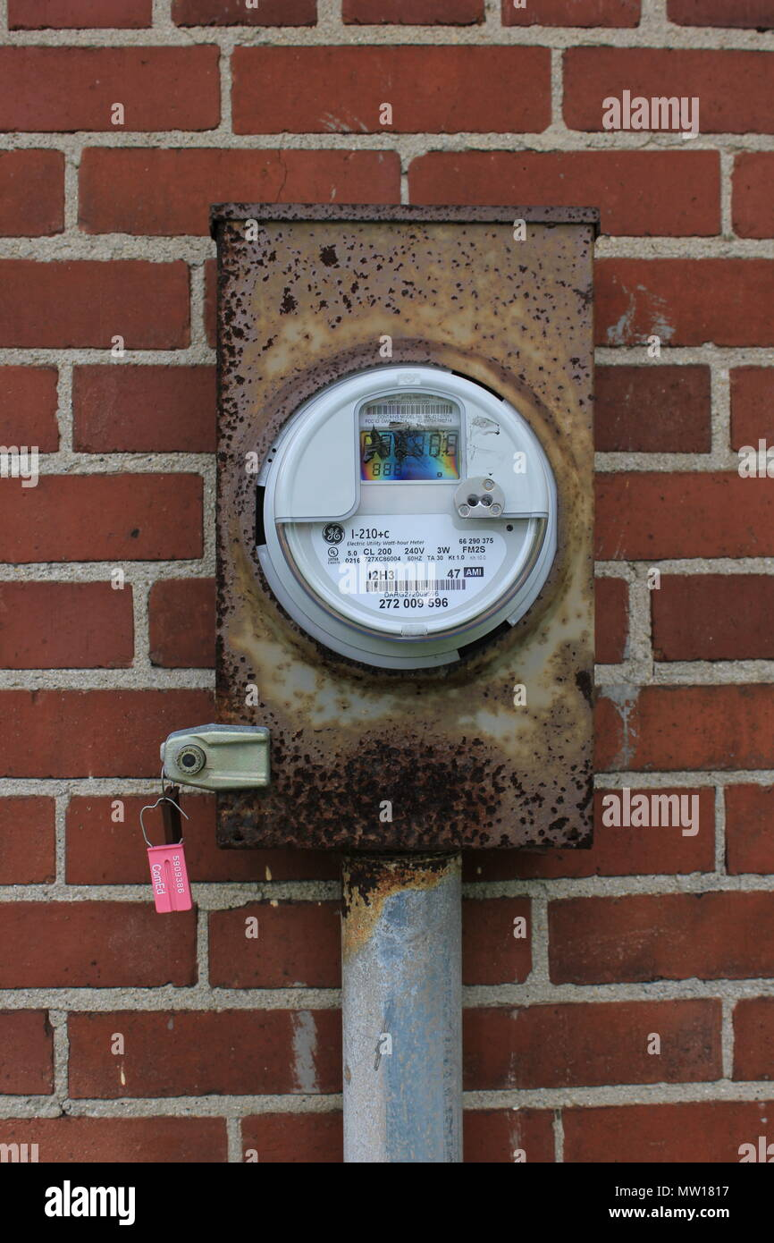 Electricity meter for a Chicago park district cute brick concession stand building. - Stock Image