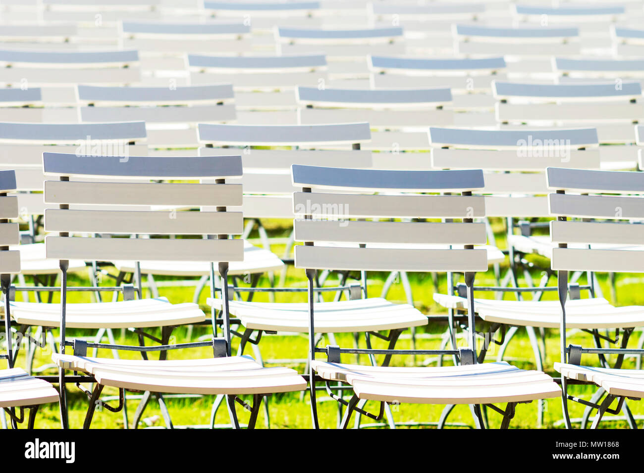 White chair rows in a spa park dark light Stock Photo