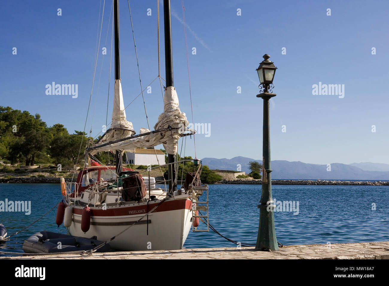 'Freelance' an unusual Freedom 30, Gaios harbour, Paxos, Greece - Stock Image
