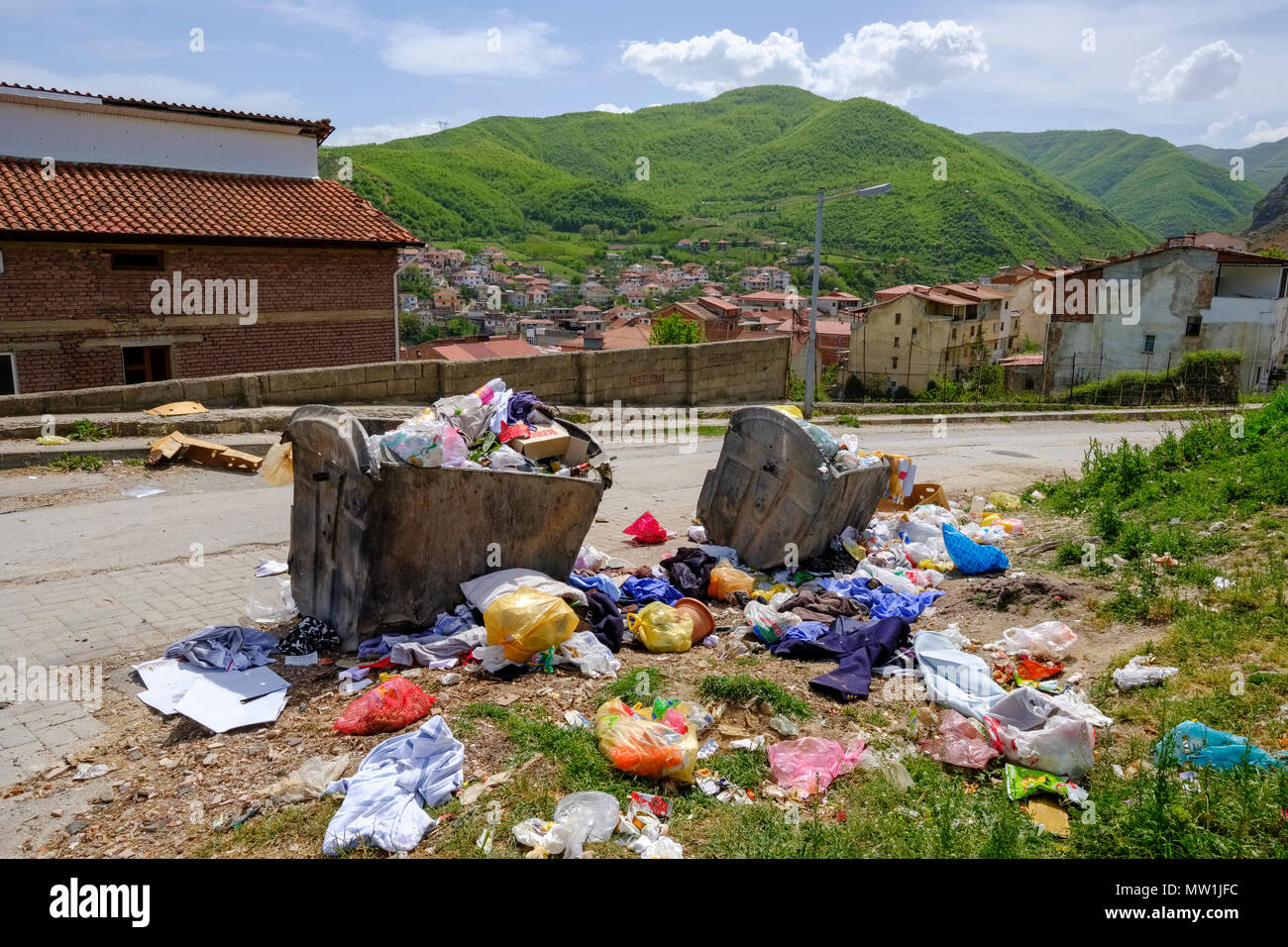 Garbage and full garbage containers on the roadside, Pogradec on Lake Ohrid, Korca region, Albania - Stock Image
