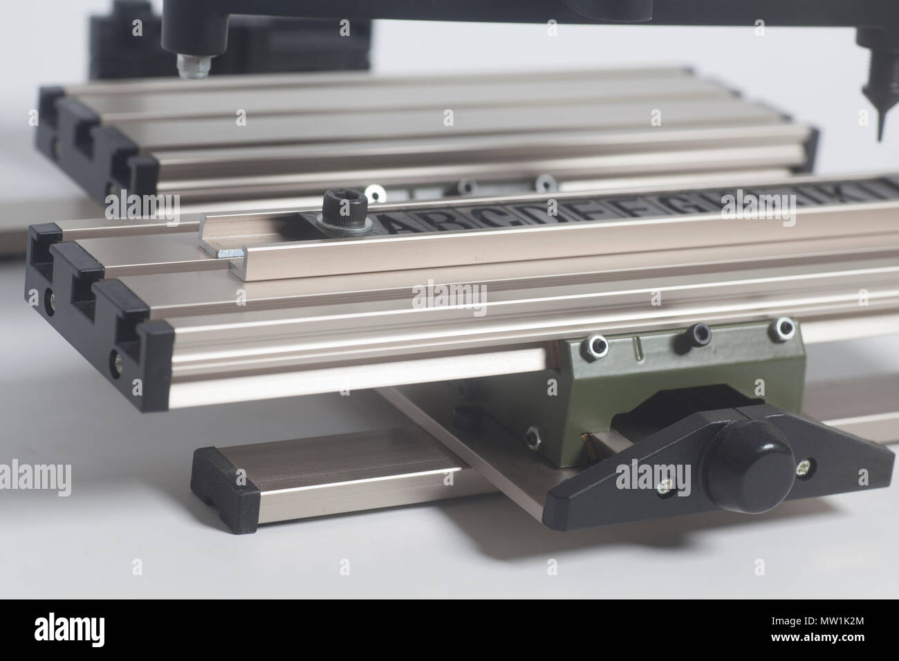 Engraving device pantograph with letterpress alphabet on a white background - Stock Image