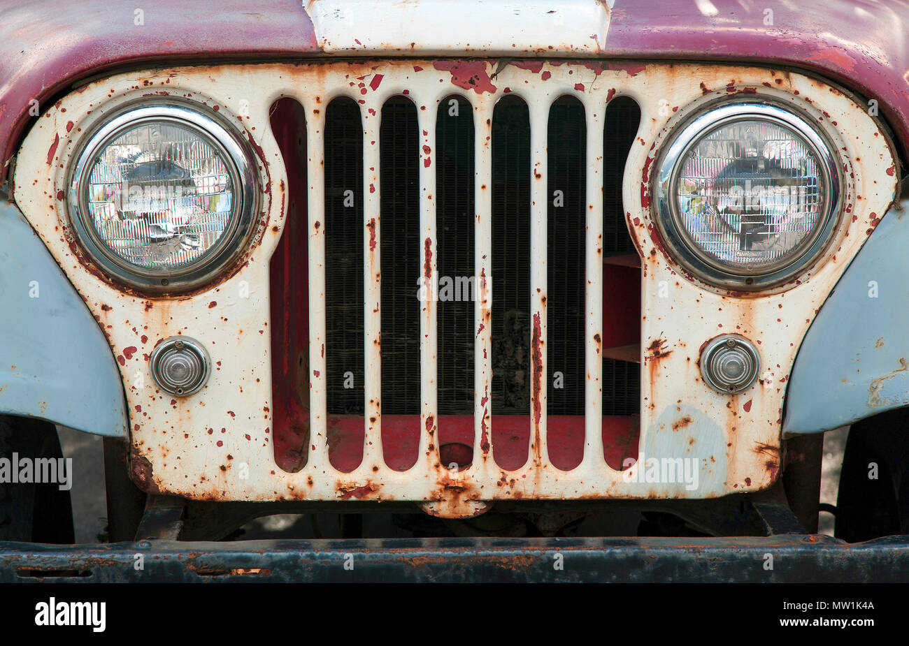Oldtimer, Jeep, 1940-1950s, radiator grill with lamps, car cemetery at Ystafell Transportation Museum - Stock Image