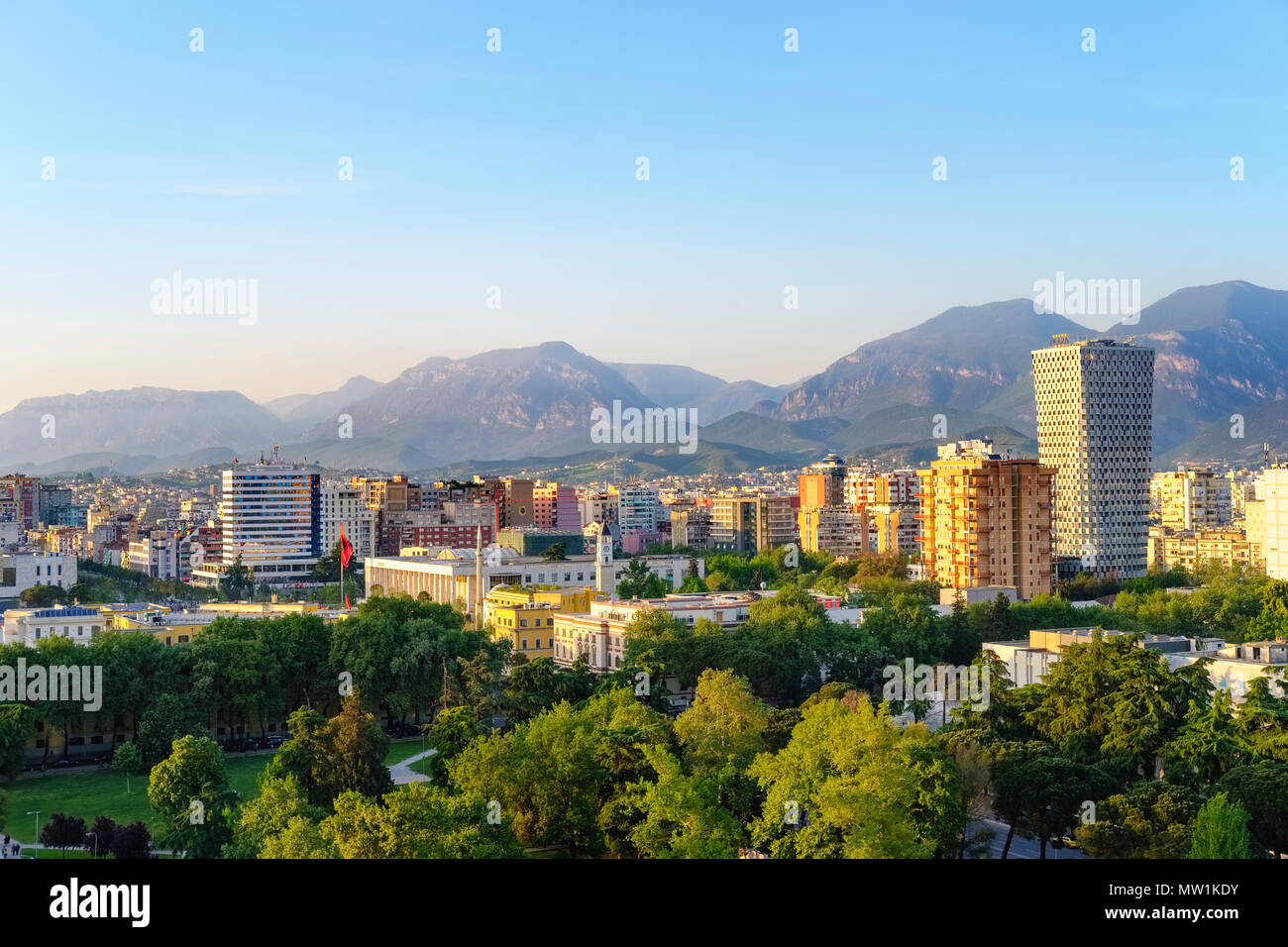 City view, city centre with culture palace and TID Tower, view from Sky Tower, mountains in the back, Tirana, Albania - Stock Image