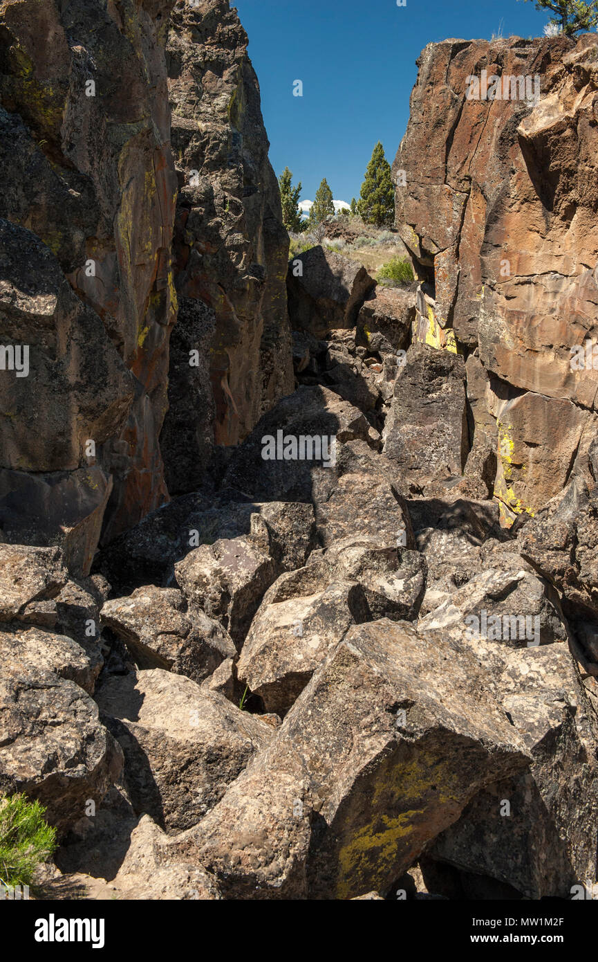 Lava blocks in the bottom of Crack In The Ground, a geological feature near Christmas Valley, Oregon - Stock Image