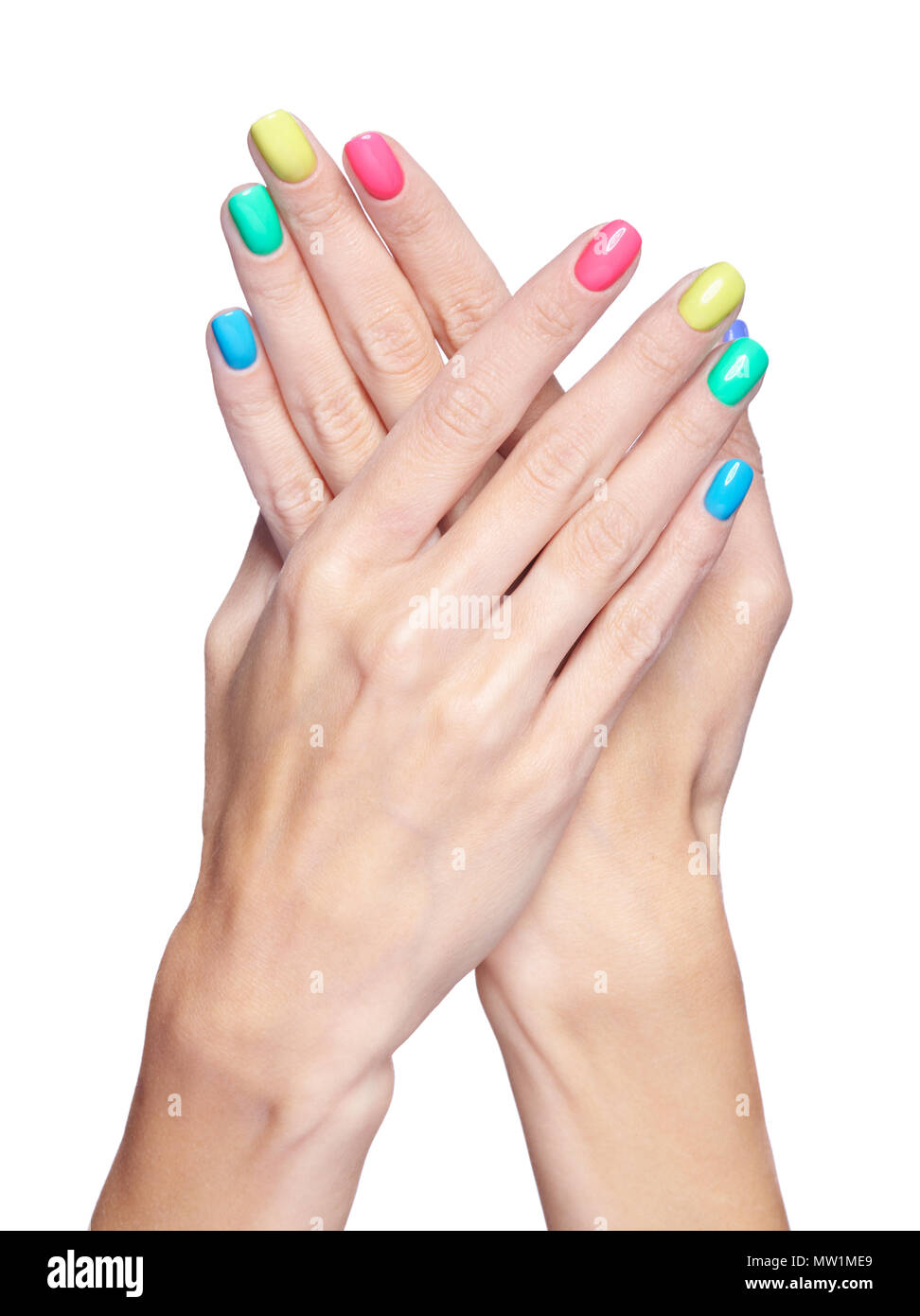 Female fingers with fancy bright green, yellow, pink and blue nails ...