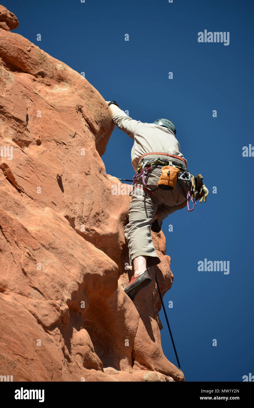 Garden of the Gods, rock climber nearing the summit of a rock formation, Colorado Springs, CO, USA Stock Photo