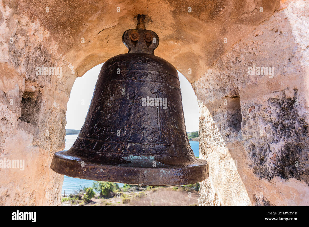 The alarm bell at the Castillo de Jagua fort, erected in 1742 by King Philip V of Spain, near Cienfuegos, Cuba. Stock Photo