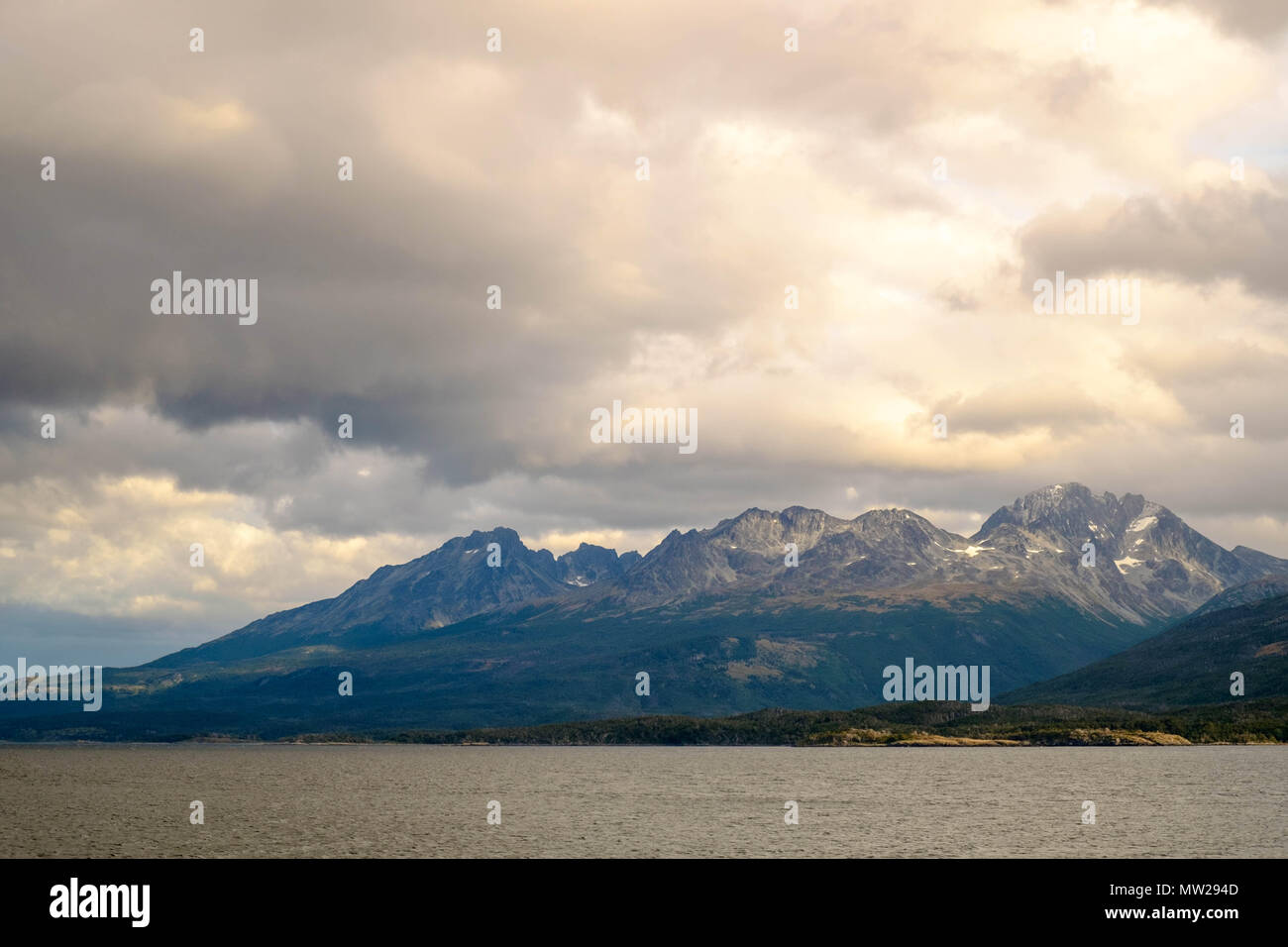 The Beagle Channel and its surrounding mountains as seen froma ferry-cruise from Punta Arenas to Puerto Williams, both in Chile. - Stock Image