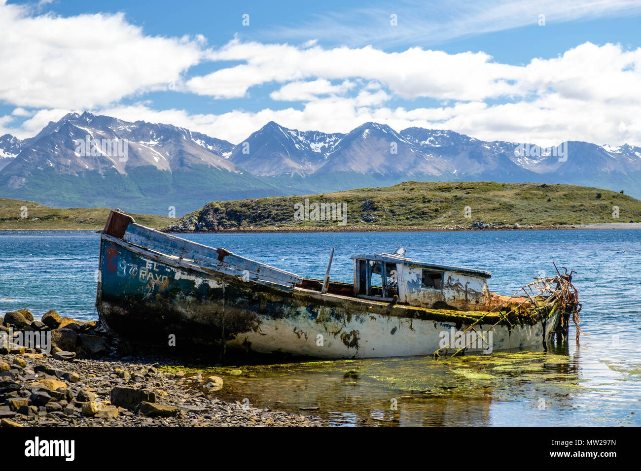 A ship wreck lies on the shore of the Beagle Channel near the small Chilean village of Puerto Navarino. The isle is an adventurous travel destination. - Stock Image