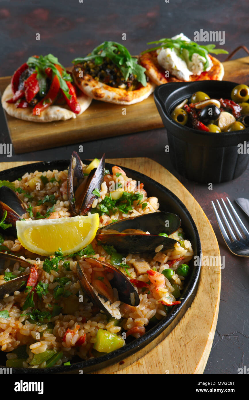 Set of tapas and paella with shrimps and mussels Stock Photo