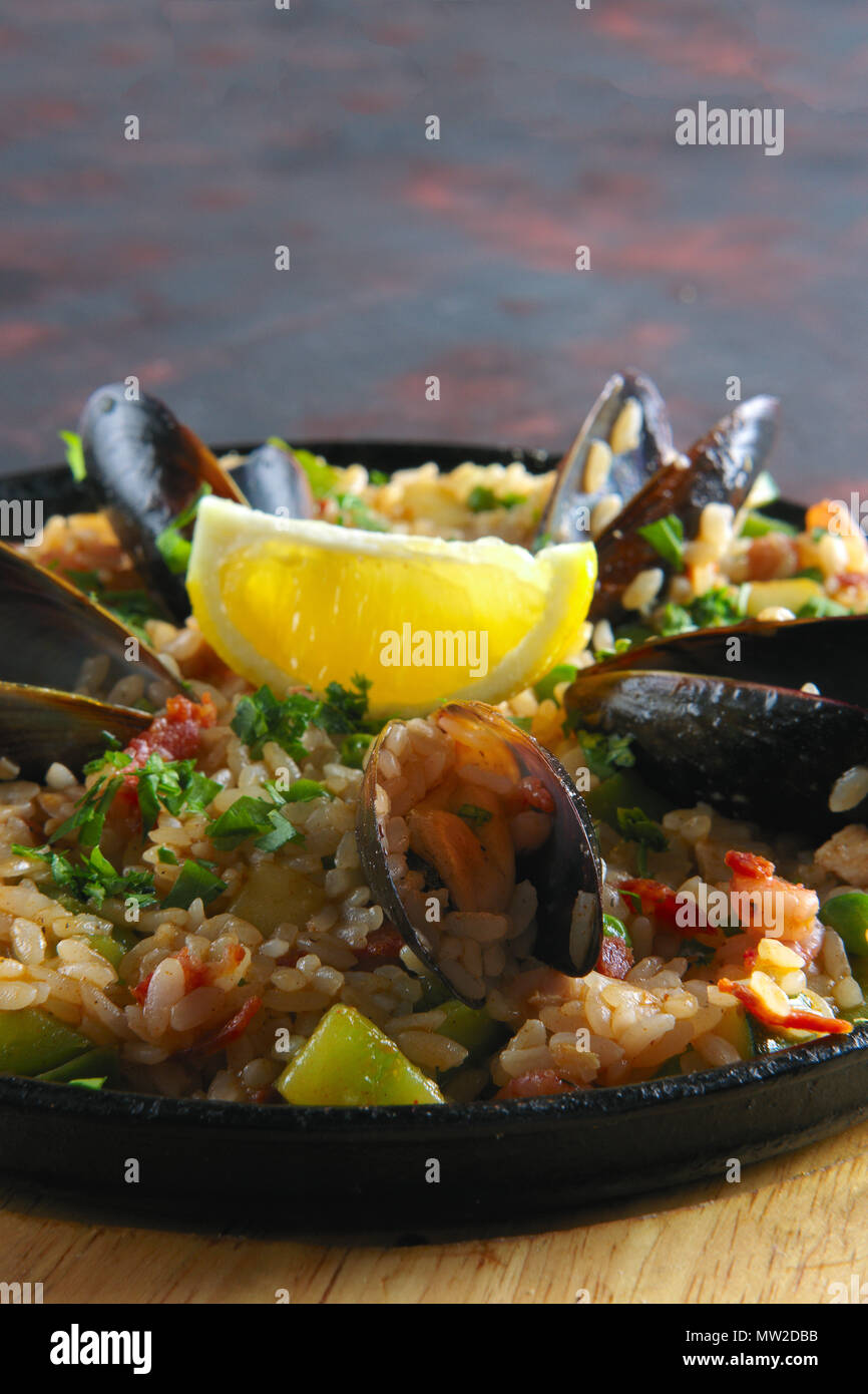 Selective focus photo of spanish paela with shrimps and mussels - Stock Image