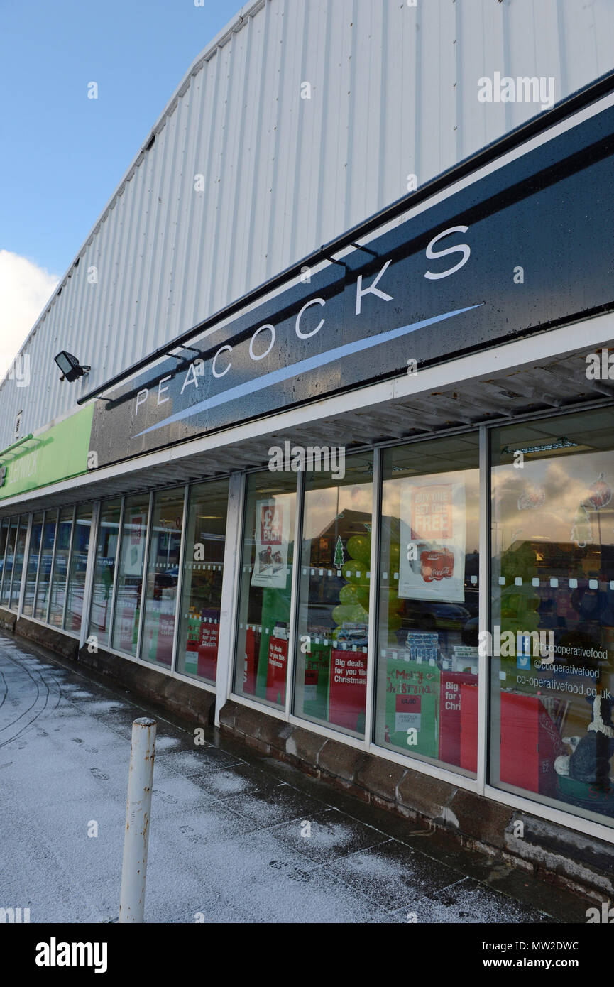 Outside and inside of Peacocks retail chain that sells clothing and calls itself a value fashion store - Stock Image