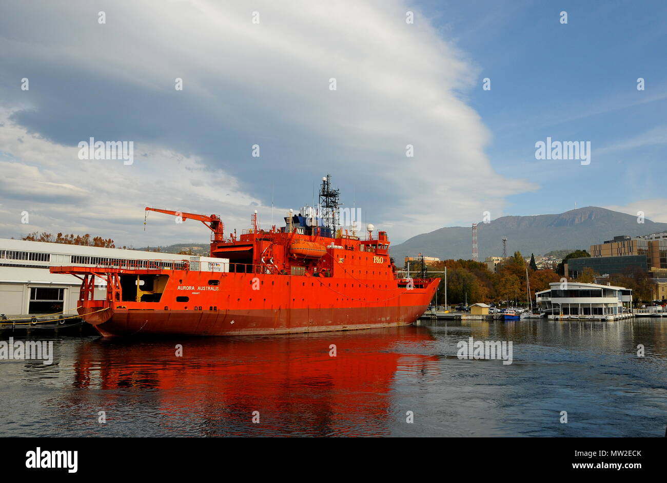 Hobart harbour, looking past the Antarctica research and supply icebreaker Aurora Australis, to Mt Wellington - Stock Image