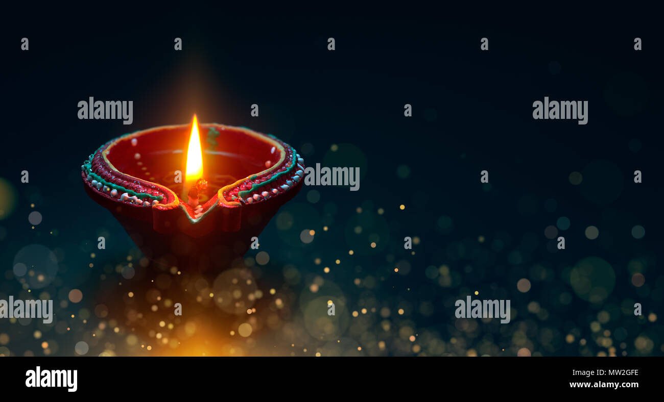 Diwali celebration - Diya lamp with magical particle - Stock Image