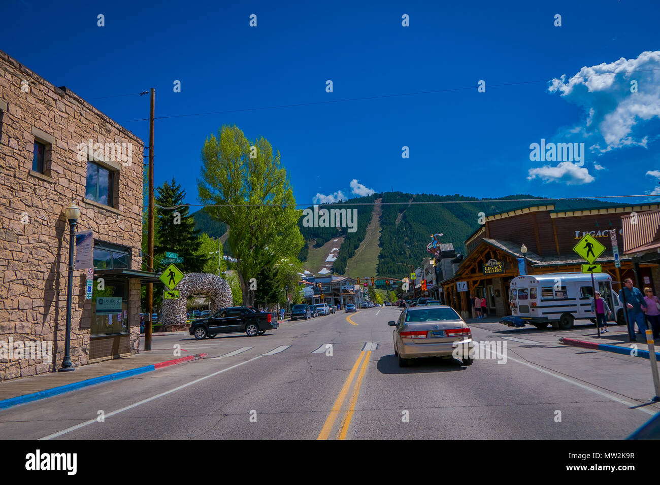 LIVINGSTON, MONTANA, USA - MAY 24, 2018: Historic centre of Livingston near Yellowstone National Park. Even in the summer time there is snow at the hill behind the city - Stock Image