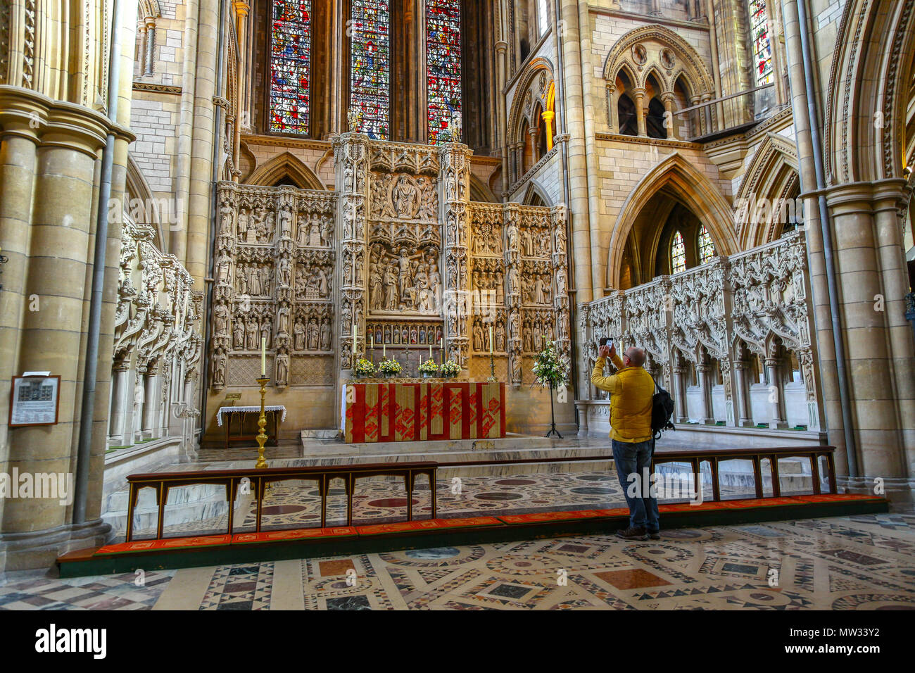 Someone taking a photo of the Altar inside The Cathedral of the Blessed Virgin Mary, Truro, Cornwall, England, UK - Stock Image