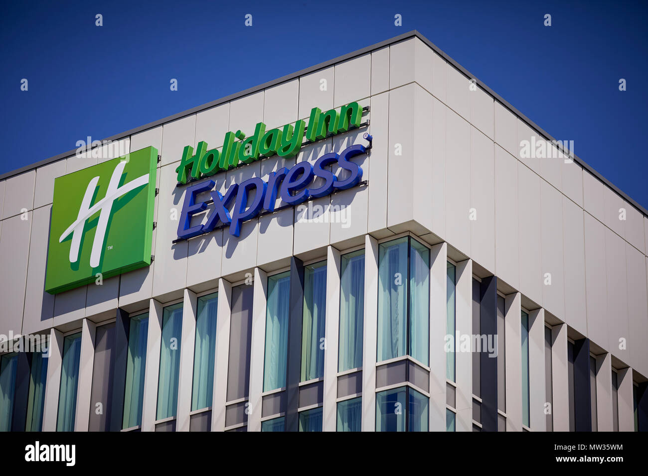 Stockport railway station  Holiday Inn Express originally a U.S. motel chain mid-priced budget hotel chain within the InterContinental Hotels Group - Stock Image