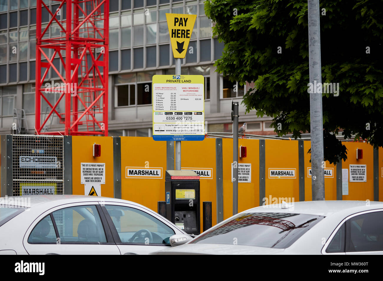 Simple. Intelligent. Parking. SIP site in the gay Village Manchester, tariff sign and pay here notice at their car park - Stock Image