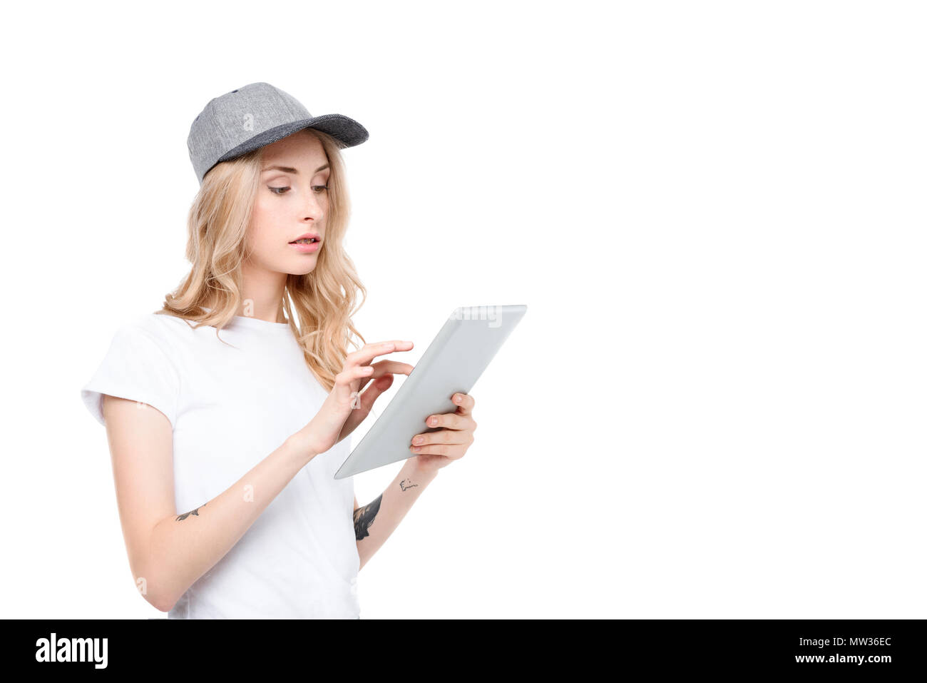 Half-length shot of a young woman using a digital tablet. - Stock Image