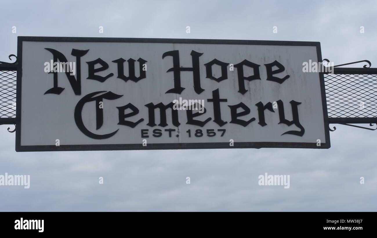 Sign over main entrance to New Hope Cemetery, located in rural Missouri.  The sign says the cemetery was established in 1857. - Stock Image