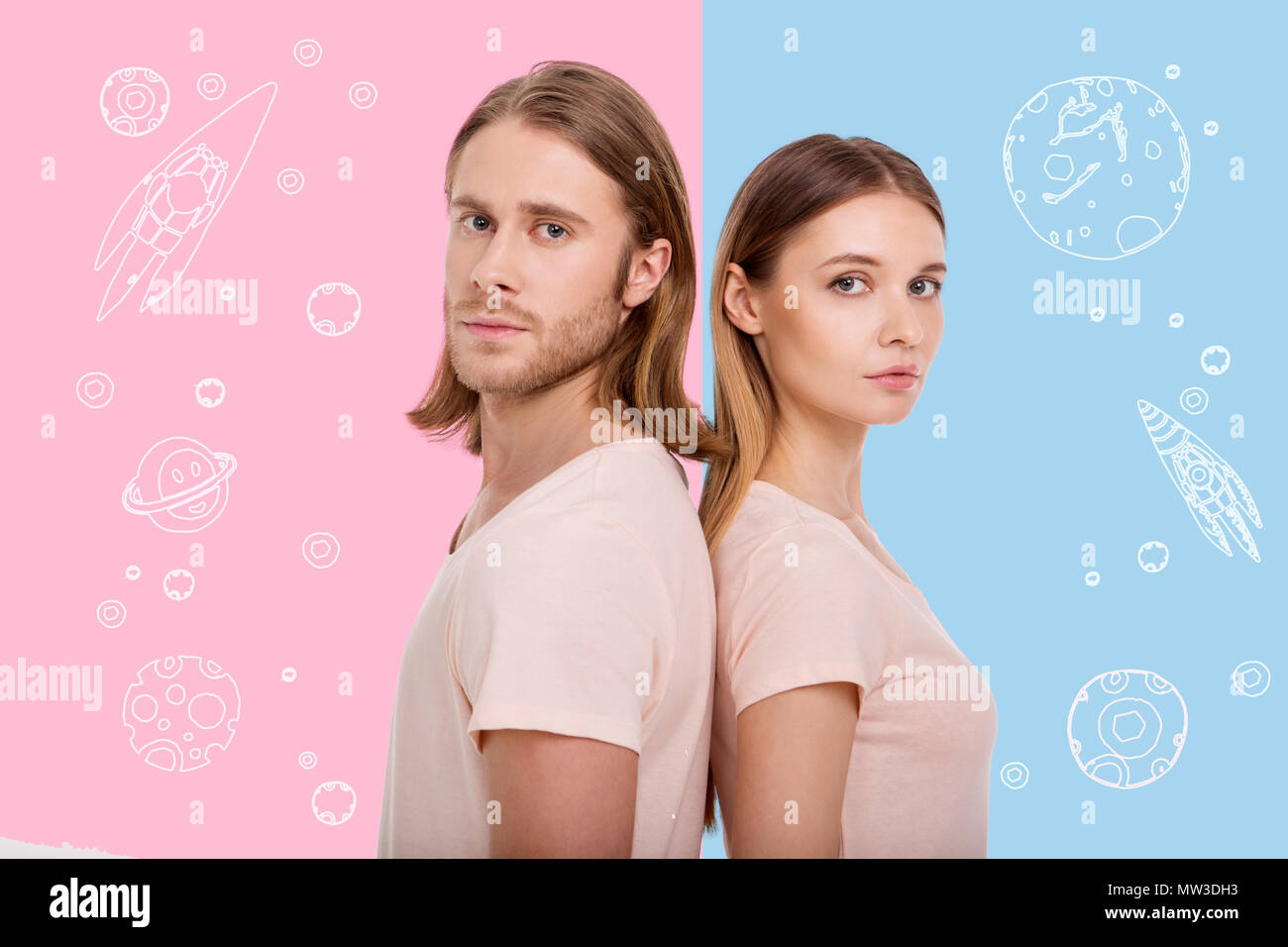 Attractive people standing back to back and dreaming about space - Stock Image
