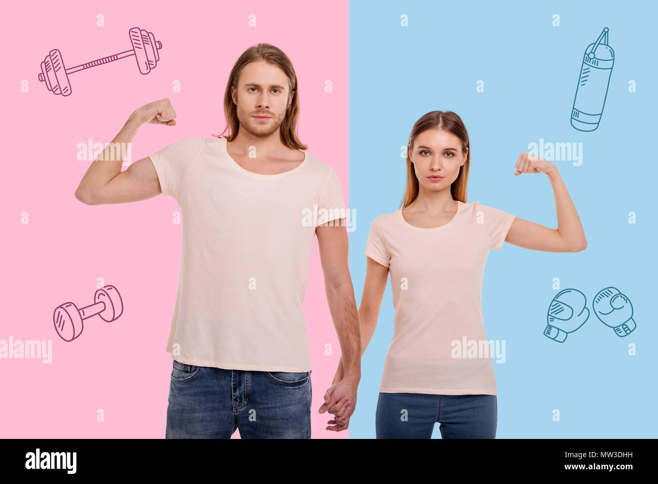 Ambitious couple of sportsmen showing their muscles and feeling confident - Stock Image