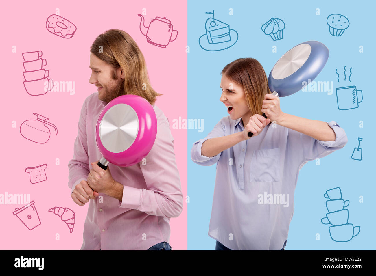 Angry woman holding a frying pan and threatening her husband - Stock Image