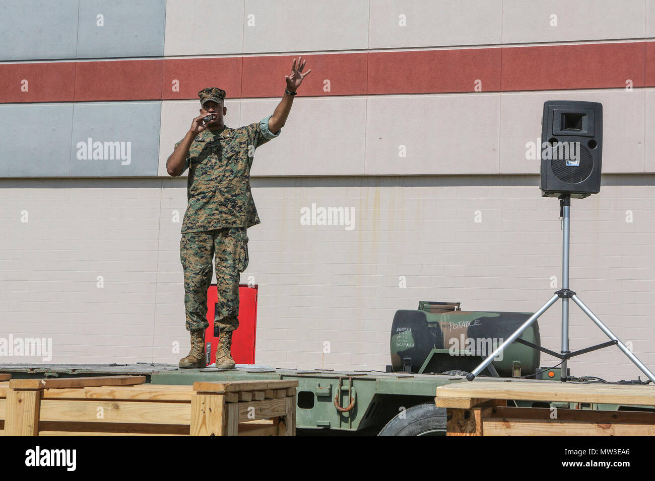 U.S. Marine Corps Lt. Col. Erik J. Smith, Commanding Officer, 2nd Maintenance Battalion, Combat Logistics Regiment 25, 2nd Marine Logistics Group, speaks at the battalion's open house event on Camp Lejeune, N.C., April 27, 2017. The event was held to create an environment that provides guests with an understanding of the battalion's mission, provide information from outside agencies, and create an opportunity for families to meet others assigned to 2d Maintenance Battalion. - Stock Image