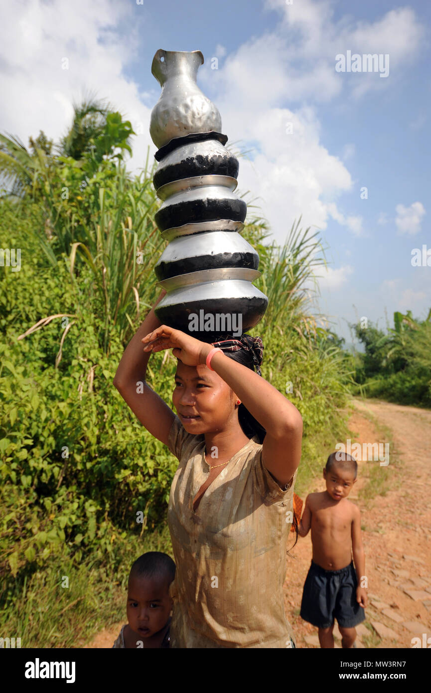 Rangamati, Bangladesh, - October 17, 2011: Tribe girls carry water from springs and wells in the remote Sajek Valley of Rangamati in Bangladesh. - Stock Image