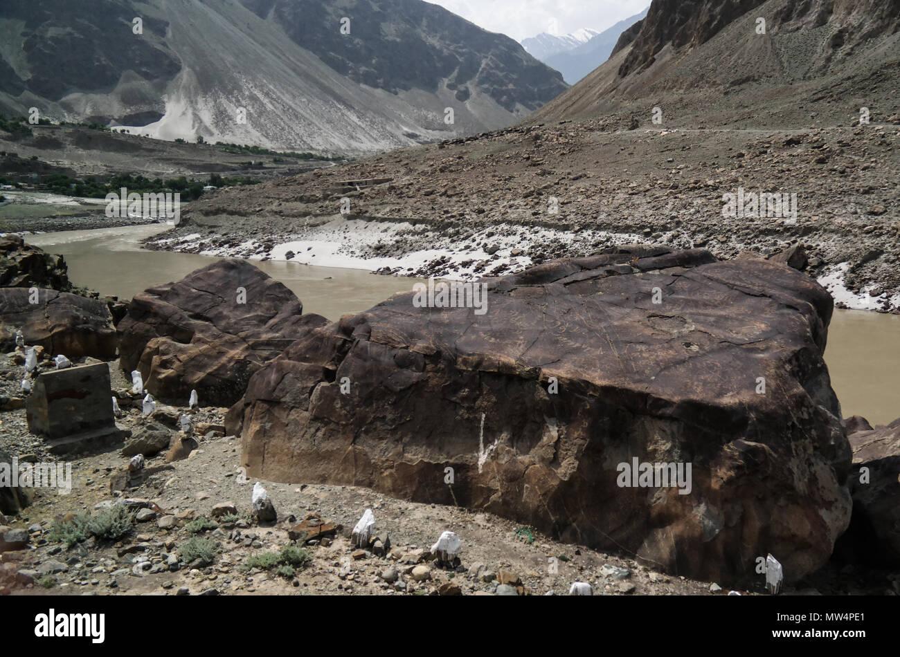 Petroglyphs at the bank of Indus river, Karakorum, Chilas Gilgit-Baltistan, Pakistan - Stock Image