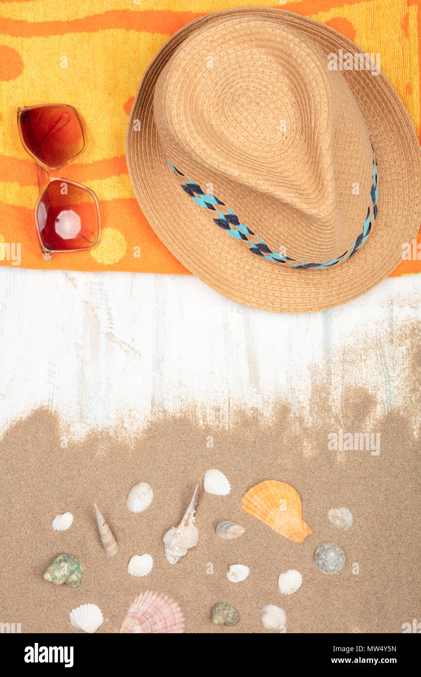 ad46d62e70d264 Summer concept. beach accessories, Straw hat ,sunglasses , beach towel with  sea shells on sandy wooden background with copy space