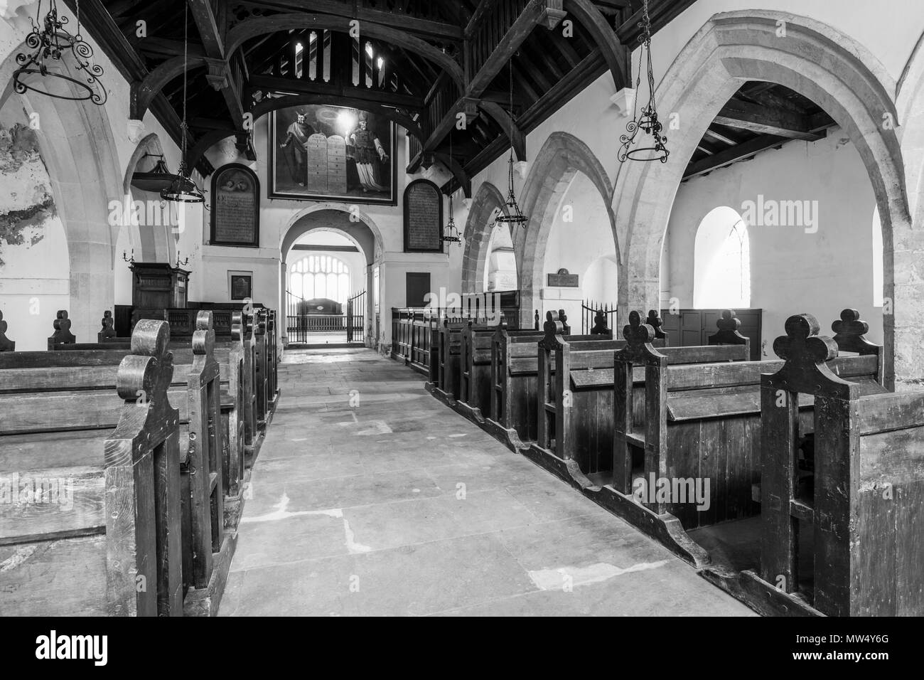 Interior b & w of historic St Martin's Church with wooden pews, aisle & hammerbeam roof in nave -  Allerton Mauleverer, North Yorkshire, England, UK. - Stock Image