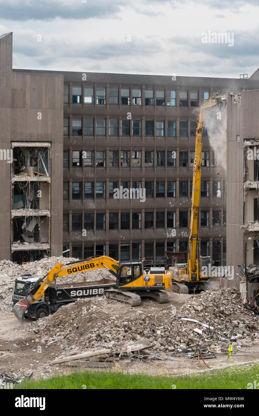 High view of demolition site with heavy machinery (excavators & dumper truck) working & demolishing office building - Hudson House  York, England, UK. - Stock Image