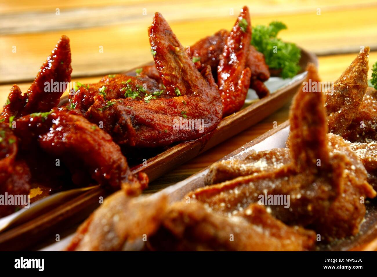 Photo of freshly cooked spicy and regular Buffalo wings - Stock Image
