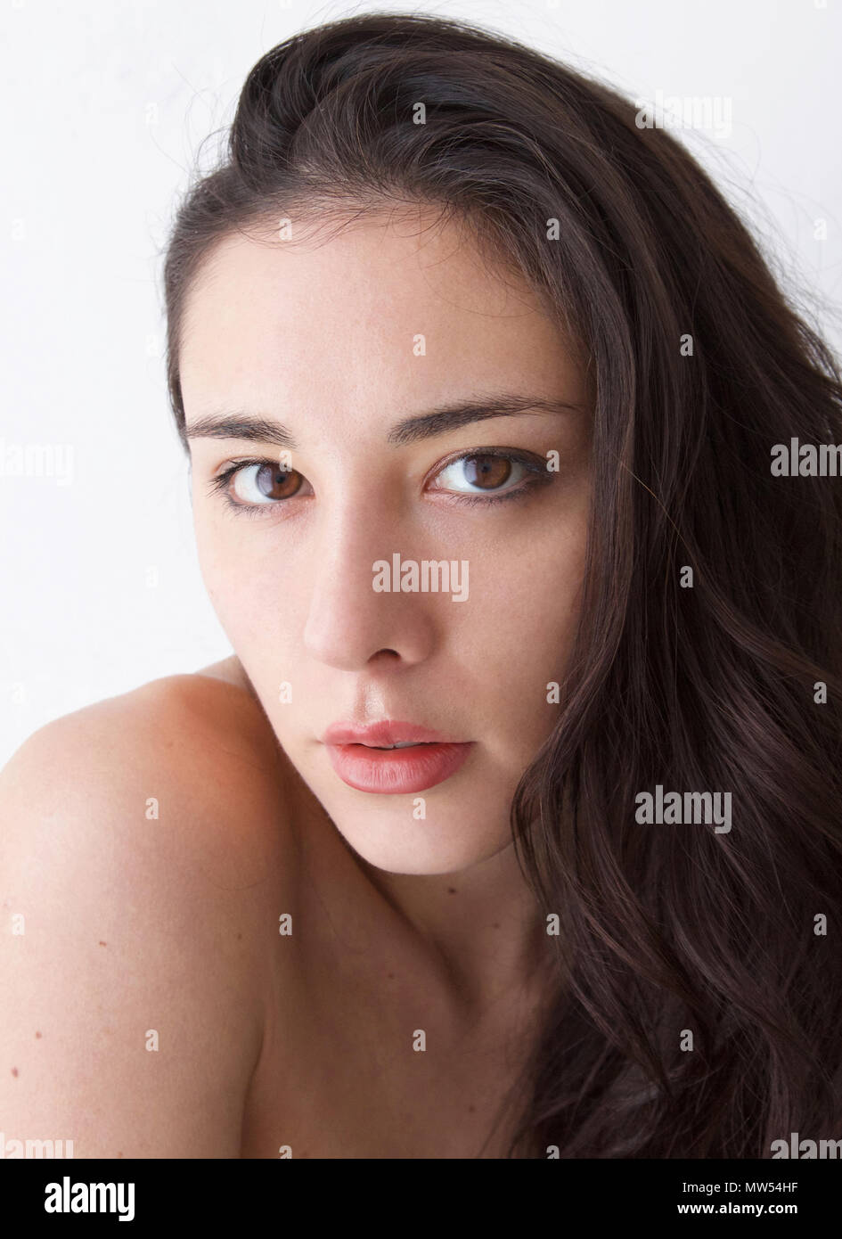 Italian Woman with brown hair and eyes and full red lips - Stock Image
