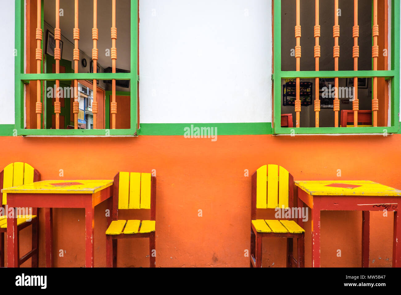 Picture of: Traditional Coffee Tables And Colourful Walls In The Streets Of Jardin Antioquia Colombia Stock Photo Alamy