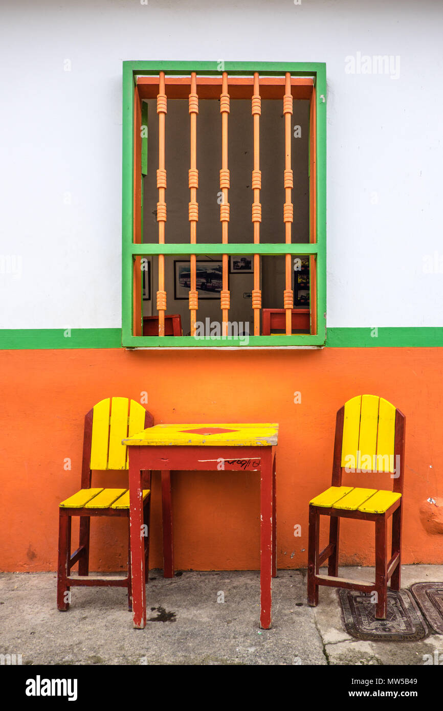 Traditional coffee tables and colourful walls in the streets of ...