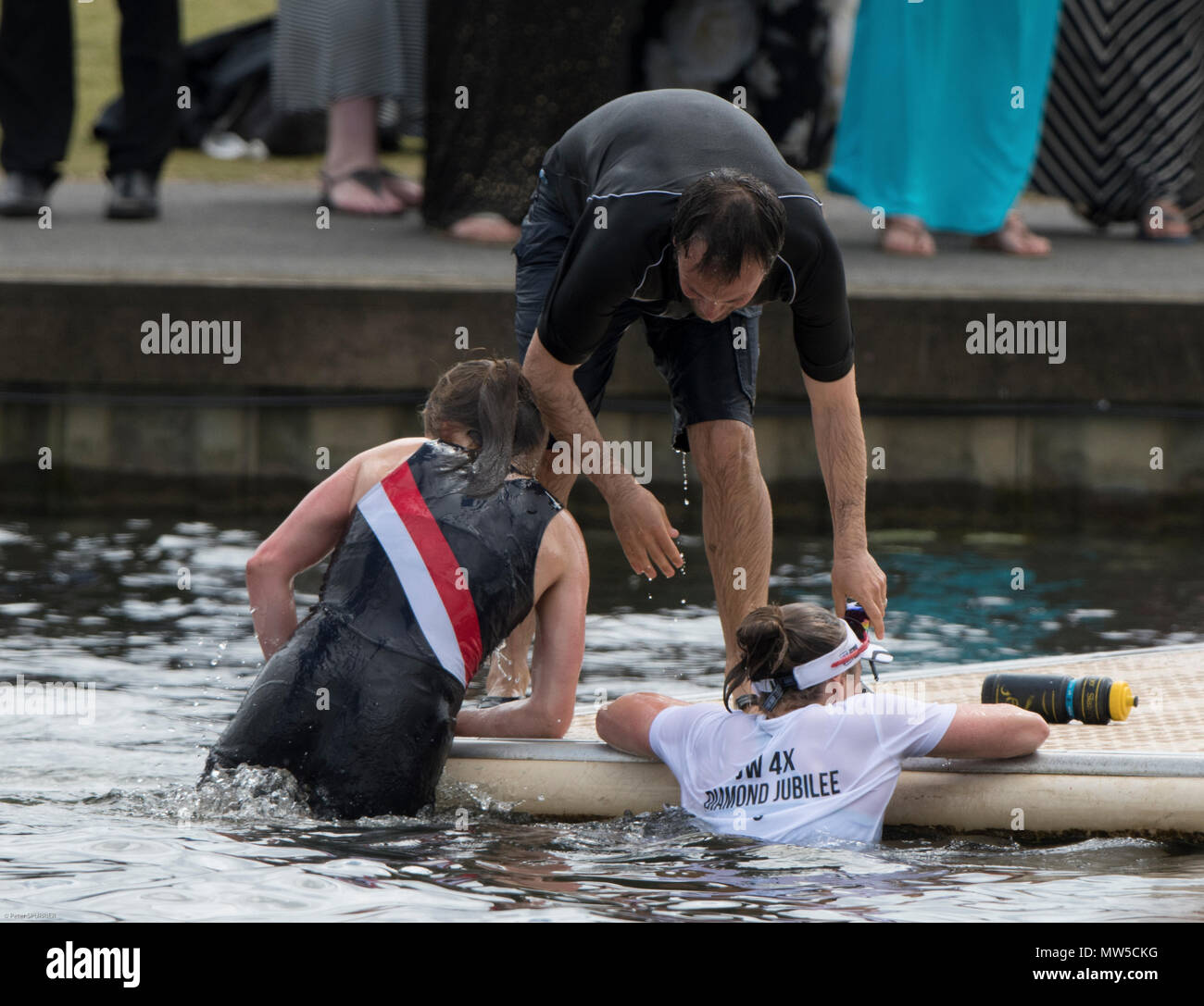 Henley on Thames. United Kingdom.      Sunday,  Coach and crew take a dip in the river Thames after the crew won the final of the Diamond Jubilee Chal - Stock Image