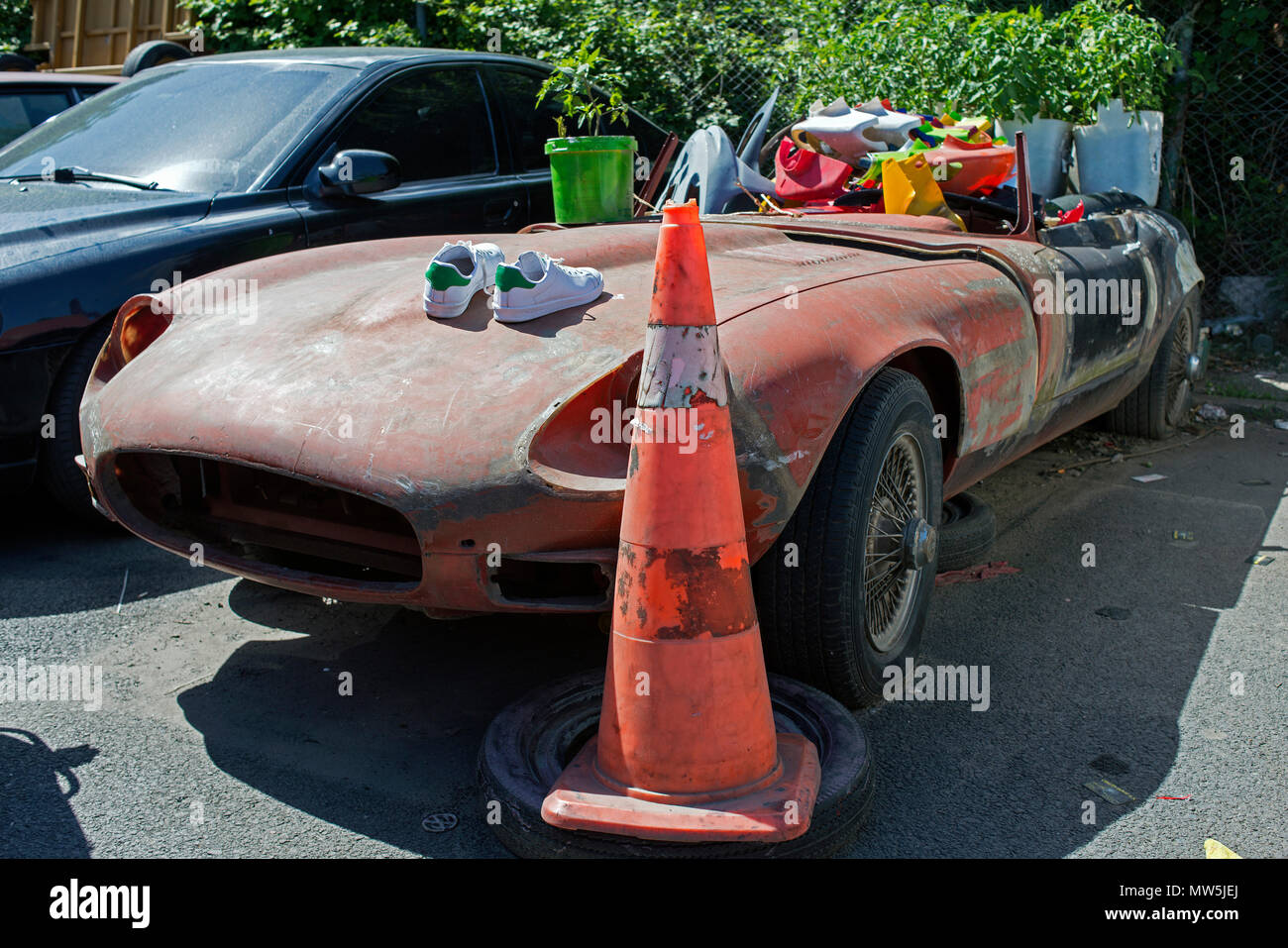 A Wrecked Jaguar Convertible Classic Vintage Car In The Street In A Park With Plastic Stuff On It In Istanbul Stock Photo Alamy