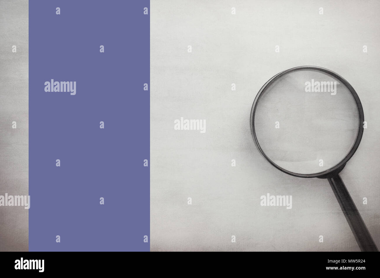 big magnyfing glass on a blank surface - directly above view - Stock Image