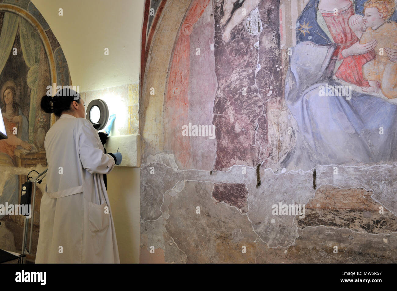 restorations of the frescos (16th century), on the right Madonna del Latte (14th century) in the deconsecrated church of Santa Marta, Rome, Italy Stock Photo