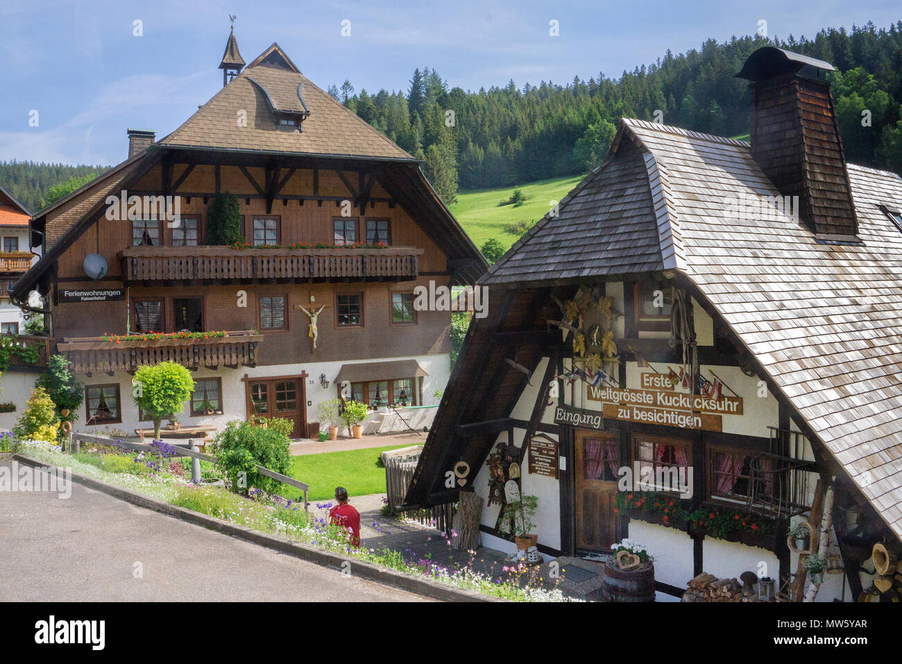Typical Black forest houses at Schonach village, Black Forest, Baden-Wuerttemberg, Germany, Europe - Stock Image