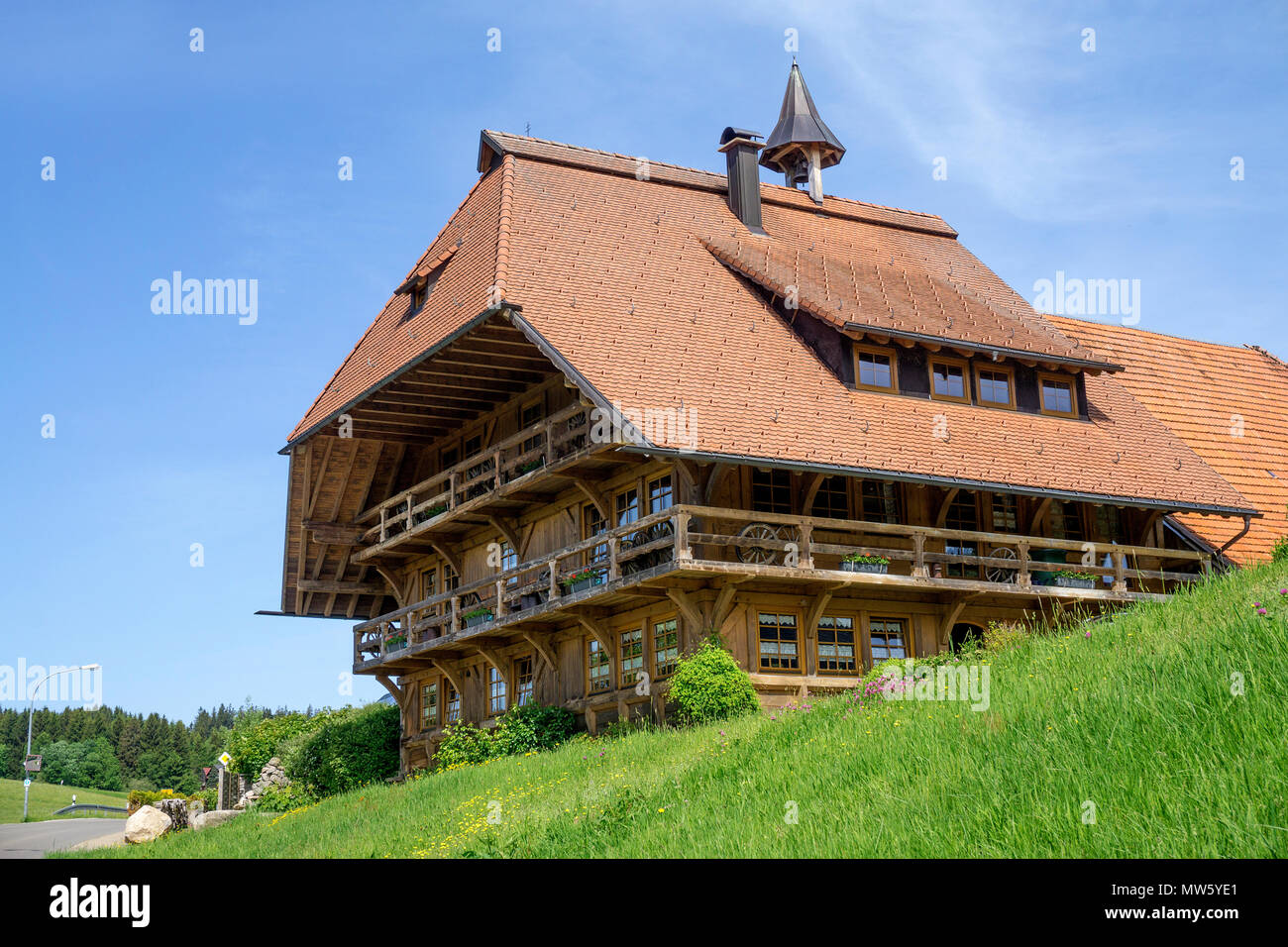 Typical wooden Black Forest house at village Schonach, Black Forest, Baden-Wuerttemberg, Germany, Europe - Stock Image