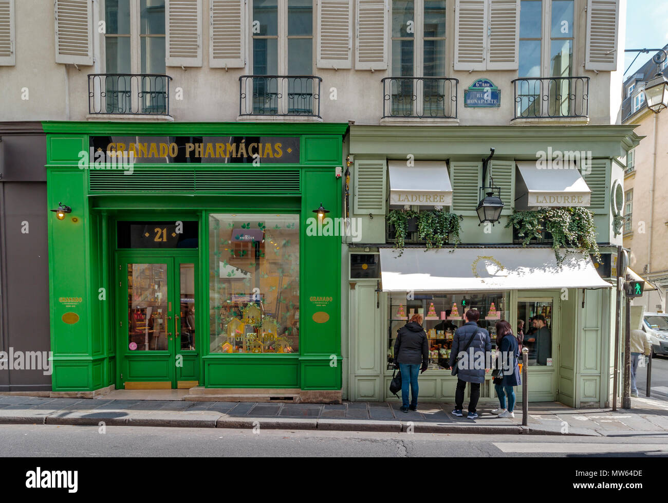 Grenado Pharmaciasa beauty product shop and Laduree a shop renowned for it's macarons side by side on Rue Bonaparte ,6th arrondissement ,Paris - Stock Image