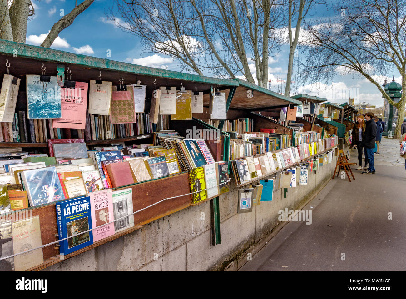 Riverside Bouquinistes ,green boxes selling second hand books along Quai Malaquais on the banks of The River Seine ,Paris ,France - Stock Image