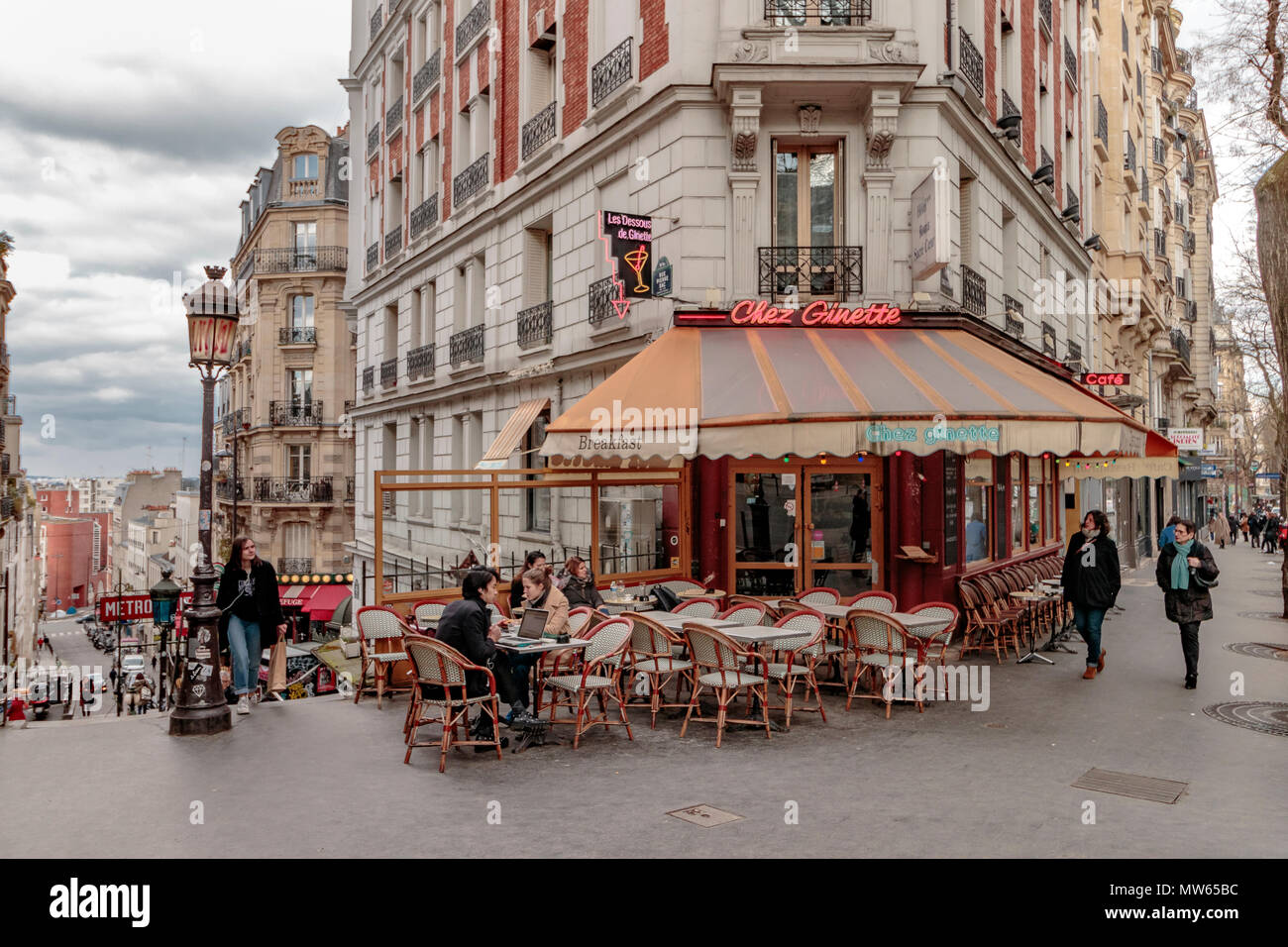 Wintertime in Paris ,people sitting outside Chez Ginette on Rue Caulaincourt, a cafe and restaurant ,Montmartre, Paris - Stock Image