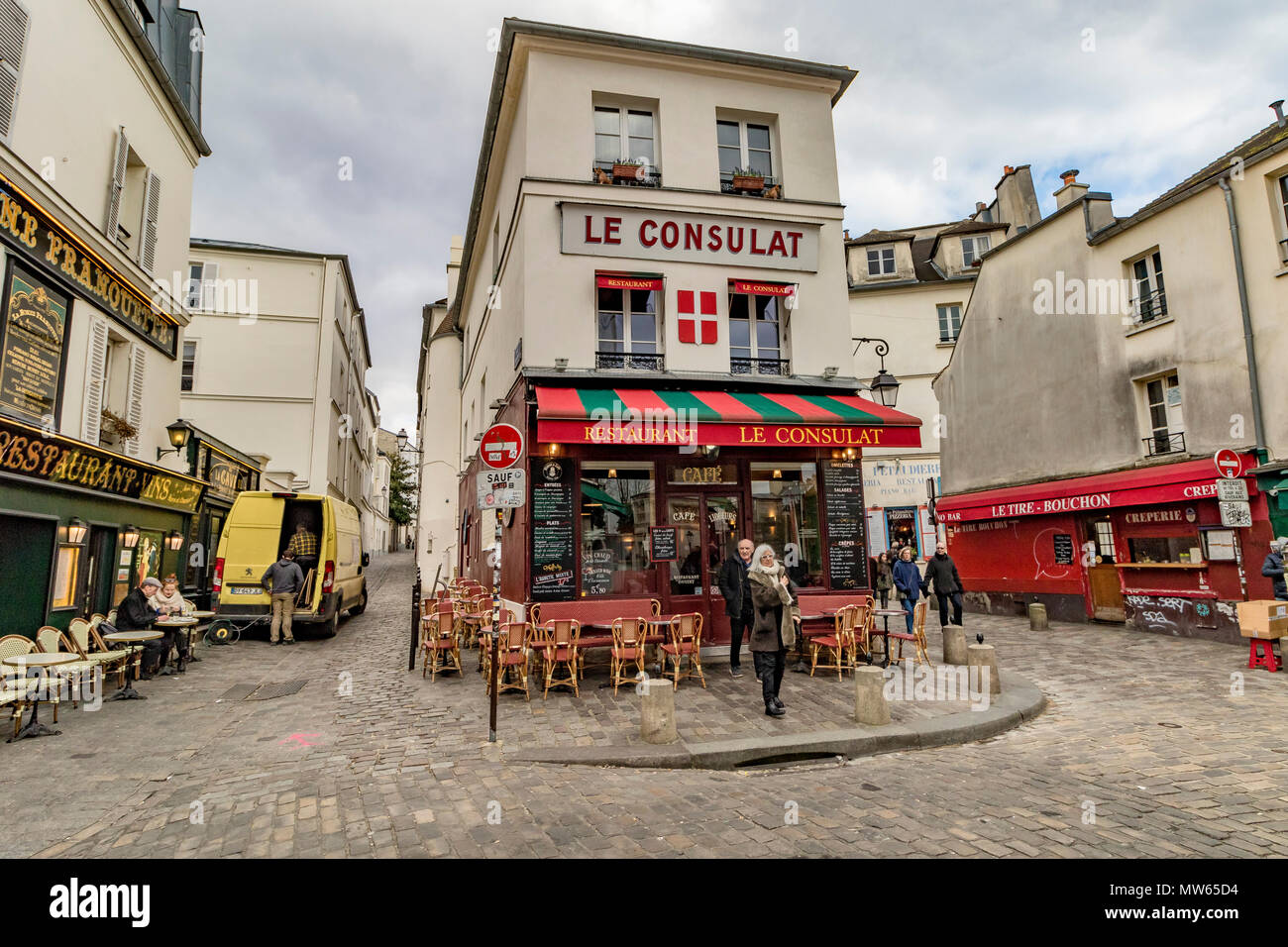 Wintertime in Paris ,tourists and visitors outside Le Consulat ,a popular restaurant and Café in Montmartre ,Paris ,France - Stock Image