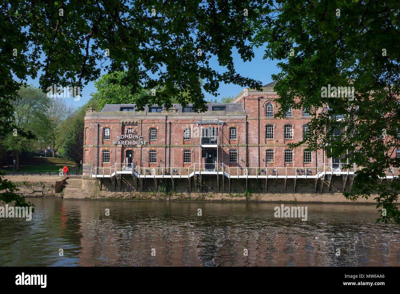 The Victorian Bonded Warehouse, transformed into luxury accommodation, fronting the River Ouse, York, UK - Stock Image