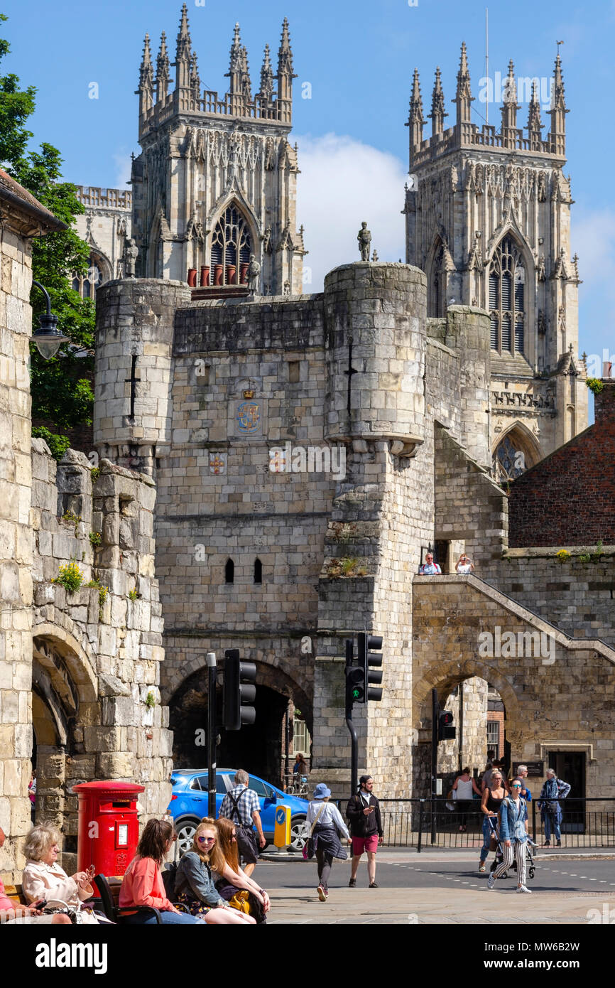 Sunlight on the Magnesian limestone of Bootham Bar and York MInster, Exhibition Square, York, UK - Stock Image
