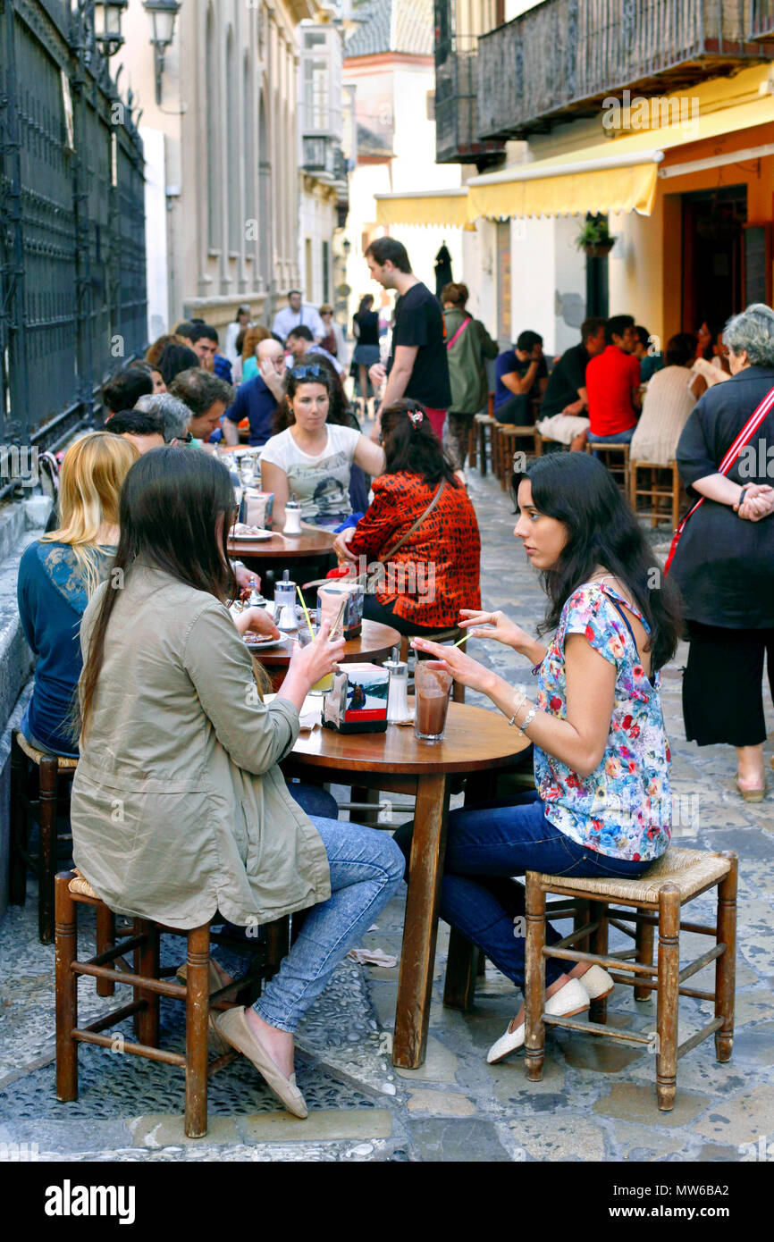"People sitting outside the popular cafe or brasserie ""La Tetería"", Calle San Agustin, Malaga, Andalusia, Spain Stock Photo"